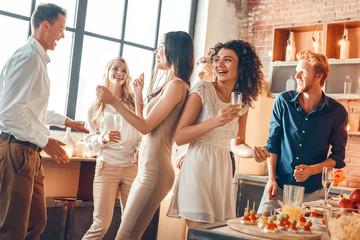 Obraz Group of friends party together indoors celebration - fototapety do salonu