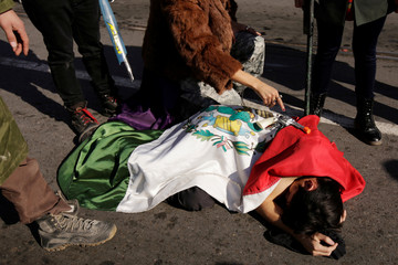 An activist performs during a protest against a law that militarises crime fighting in the country in Ciudad Juarez, Mexico