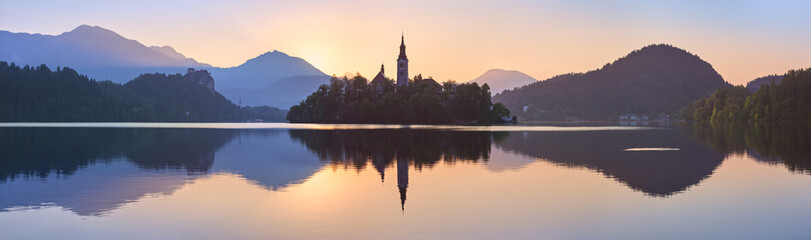 Church and Castle in lake Bled, Slovenia at sunset, scenic summer panorama Wall mural