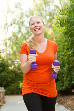 Healthy woman exercising and getting fit.