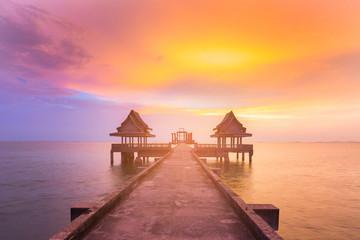 Walkway leading on ocean skyline during sunset, natural landscape background