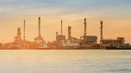 Industrial oil refinery plant river front, heavy industial background sunset tone