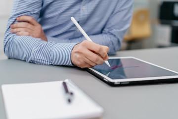 Illustrator or designer working on a tablet