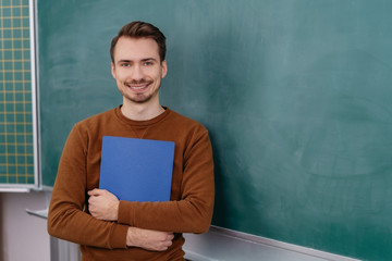 Smiling relaxed graduate clutching a CV