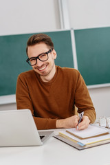 Joyful friendly young teacher