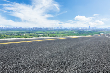 Empty highway asphalt road and beautiful sky clouds landscape Wall mural