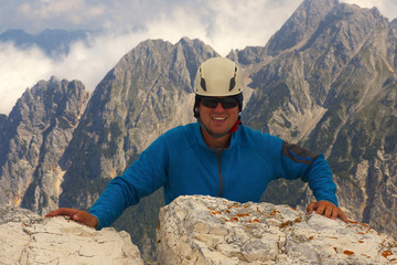 Climber with a mountain landscape on bacground, Triglav National Park, Slovenia