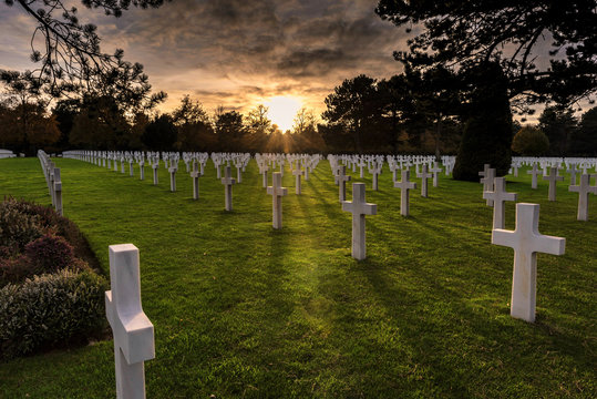 The sun sets over the American Cemetery in Colleville-sur-Mer, Normandy, France.