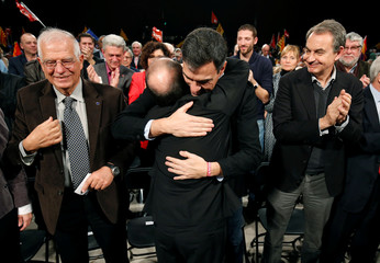 Socialist Party of Catalonia (PSC) leader Miquel Iceta is embraced by PSOE leader Pedro Sanchez next to Josep Borrell and Former Spain Prime minister Jose Luis Rodriguez Zapatero during a meeting in Barcelona
