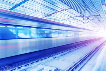 A train running at a subway station.