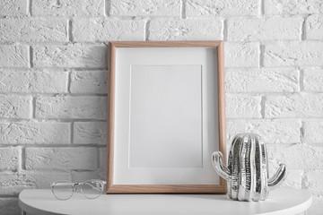 Mockup of blank frame on table