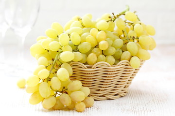Grapes in a basket on a table