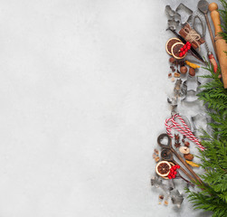 Christmas cakes, ingredients and utensils to homemade cookies on a light background.