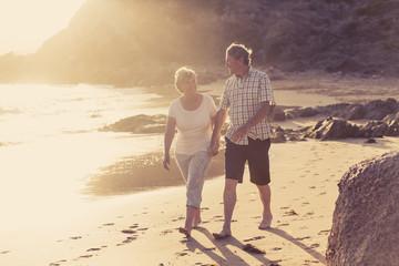 lovely senior mature couple on their 60s or 70s retired walking