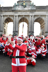 A woman takes a selfie as bikers dressed as Santa Claus meet at the Parc du Cinquantenaire in Brussels