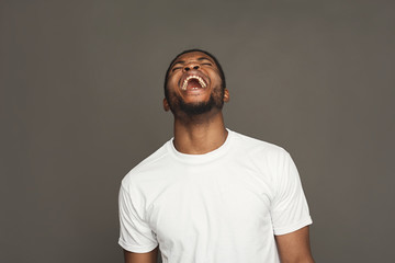 Facial expression, emotions, friendly black man laughing Wall mural