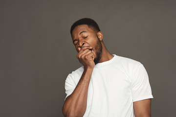 Facial expression, emotions, friendly black man yawning Wall mural