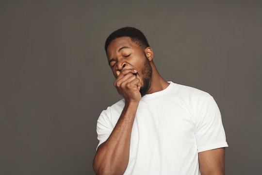 Facial expression, emotions, friendly black man yawning