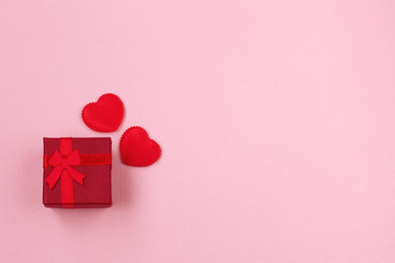 Valentine's day composition, red gift box with ribbon