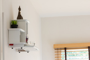 buddha statue on white shelf