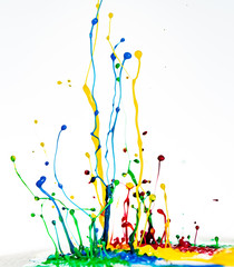 color dancing splashes of paint on a white background
