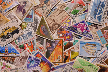 Old postage stamps from different countries as background