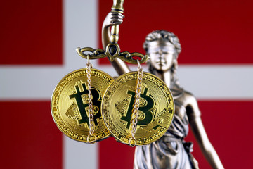 Symbol of law and justice, physical version of Bitcoin and Denmark Flag. Prohibition of cryptocurrencies, regulations, restrictions or security, protection, privacy.