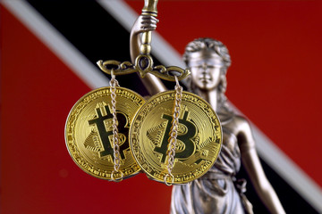Symbol of law and justice, physical version of Bitcoin and Trinidad and Tobago Flag. Prohibition of cryptocurrencies, regulations, restrictions or security, protection, privacy.