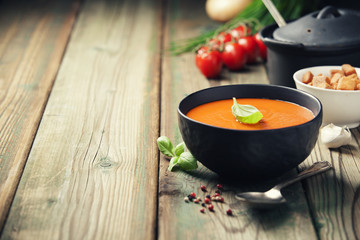 Homemade tomato soup (or gazpacho) over old wooden background