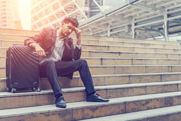 Unemployed businessman stress sitting on stair, concept of business failure and unemployment problem, work life balance.