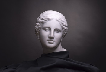 Gypsum bust isolated on black background, student work