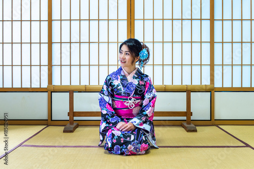 Wall mural Asian woman wearing japanese traditional kimono in Japan.