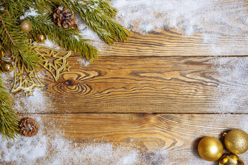 Christmas frame made of fir branches, festive decorations and pine cones on wooden table. Christmas background.