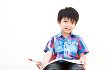 Education Concept of Little Boy Studying with Happy Emotion in Classroom on White Background with Copy Space