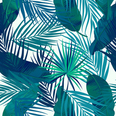Green tropical palm leaves seamless pattern