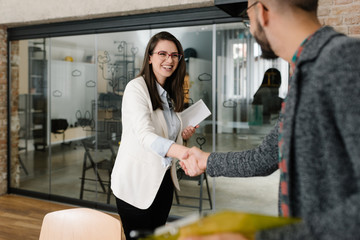 Openly greeting a job recruiter with a firm handshake Wall mural