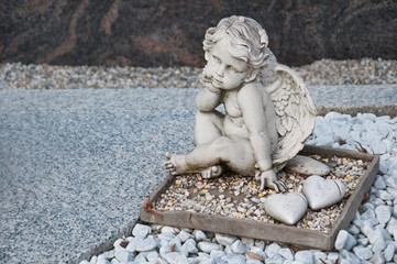angel sitting on a grave