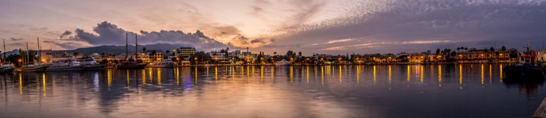 Kos town harbour panorama at sunset
