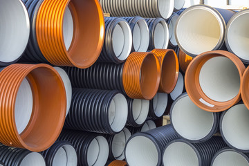 Stack of corrugated PVC sewer or drain pipes