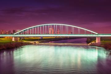 Poster Crimson Sava river night view. / Night view at famous scenery in Zagreb city, River Sava.