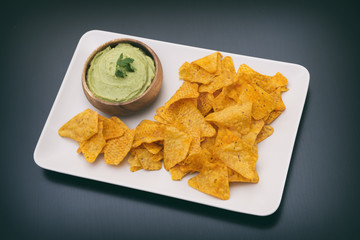 Plate Full Of Corn Chips And Guacamole (Avocado Sauce)