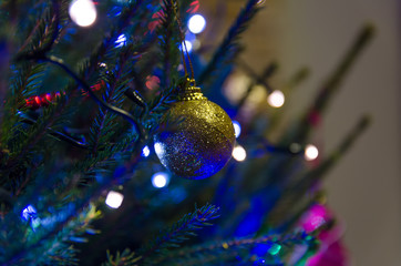 Christmas decorations on the Christmas tree. Colorful lamps and other decorations.