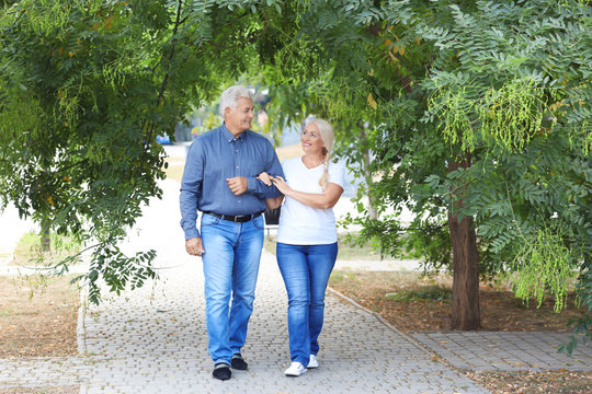 Mature couple walking together in park