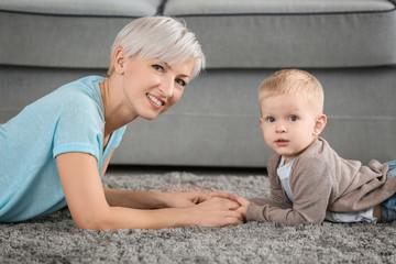 Attractive young mother with her baby at home