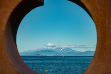 Scenery view of Tongariro national park view look through the sculpture decoration in Taupo town in North Island of New Zealand.