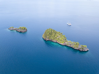 Aerial of Ship and Limestone Islands in Raja Ampat