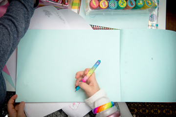 Children using art equipment to draw and make pictures, close up of hands