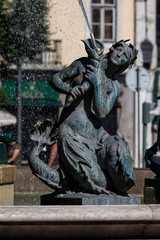 Bronze divinity statues in the Rossio Square's fountain, built in 1889 in Lisbon, Portugal