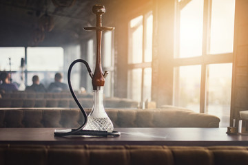 Stylish hookah made of glass and wood