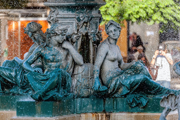 Bronze divinity statues in the fountain